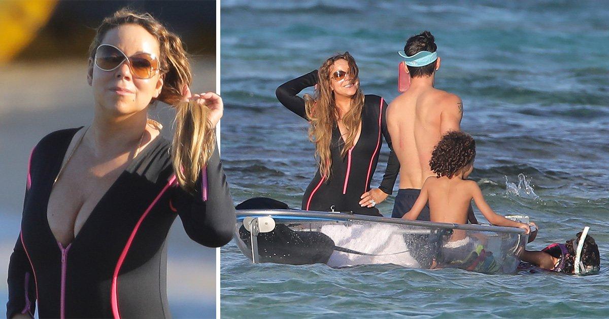Mariah Carey poses seductively for boyfriend Bryan Tanaka in the sea