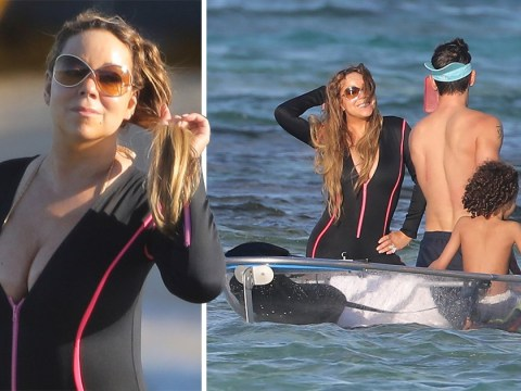 Mariah Carey poses seductively for boyfriend Bryan Tanaka in the sea