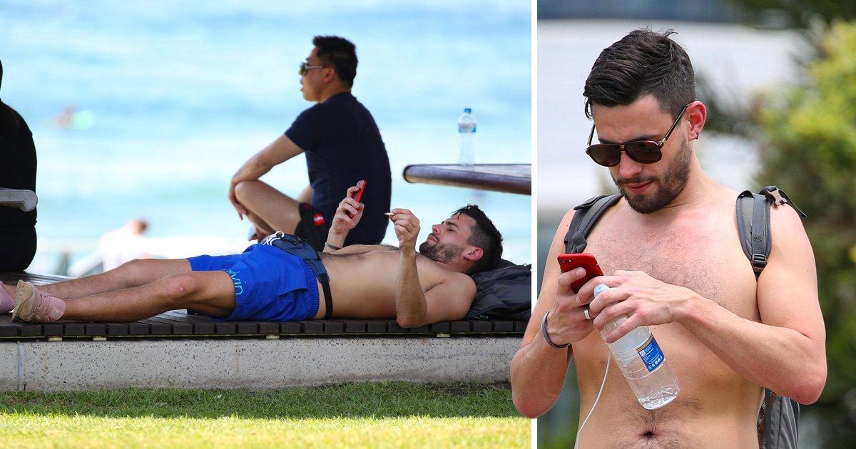 Andrew Brady chills out in Bondi as he 'moves to Australia' following Caroline Flack split