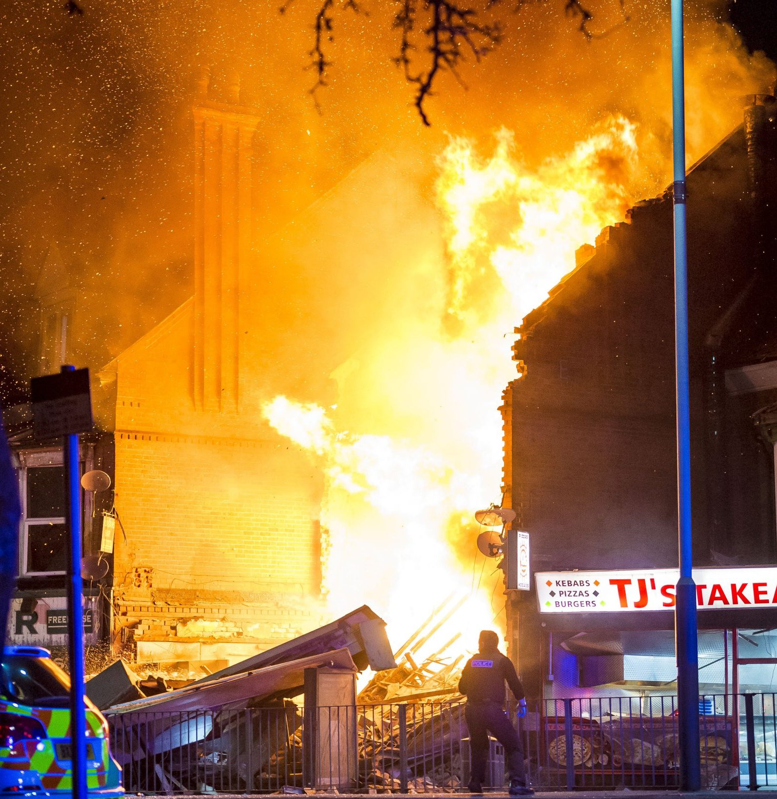 "Police have declared a ""major incident"" after reports of a ""massive explosion"" in a shop and flats. Emergency crews rushed to the scene after the blast at about 7pm. Dramatic pictures show flames erupting from the store on Hinckley Road, Leicester, after witnesses told of hearing a ""massive explosion."" The building is in a terrace of shops, to the left of TJs, near Hinckley Road post office. It appears to have been reduced to blazing rubble. Debris from the building has been blasted across both carriageways of Hinckley Road See NTI story NTIEXPLODE;"