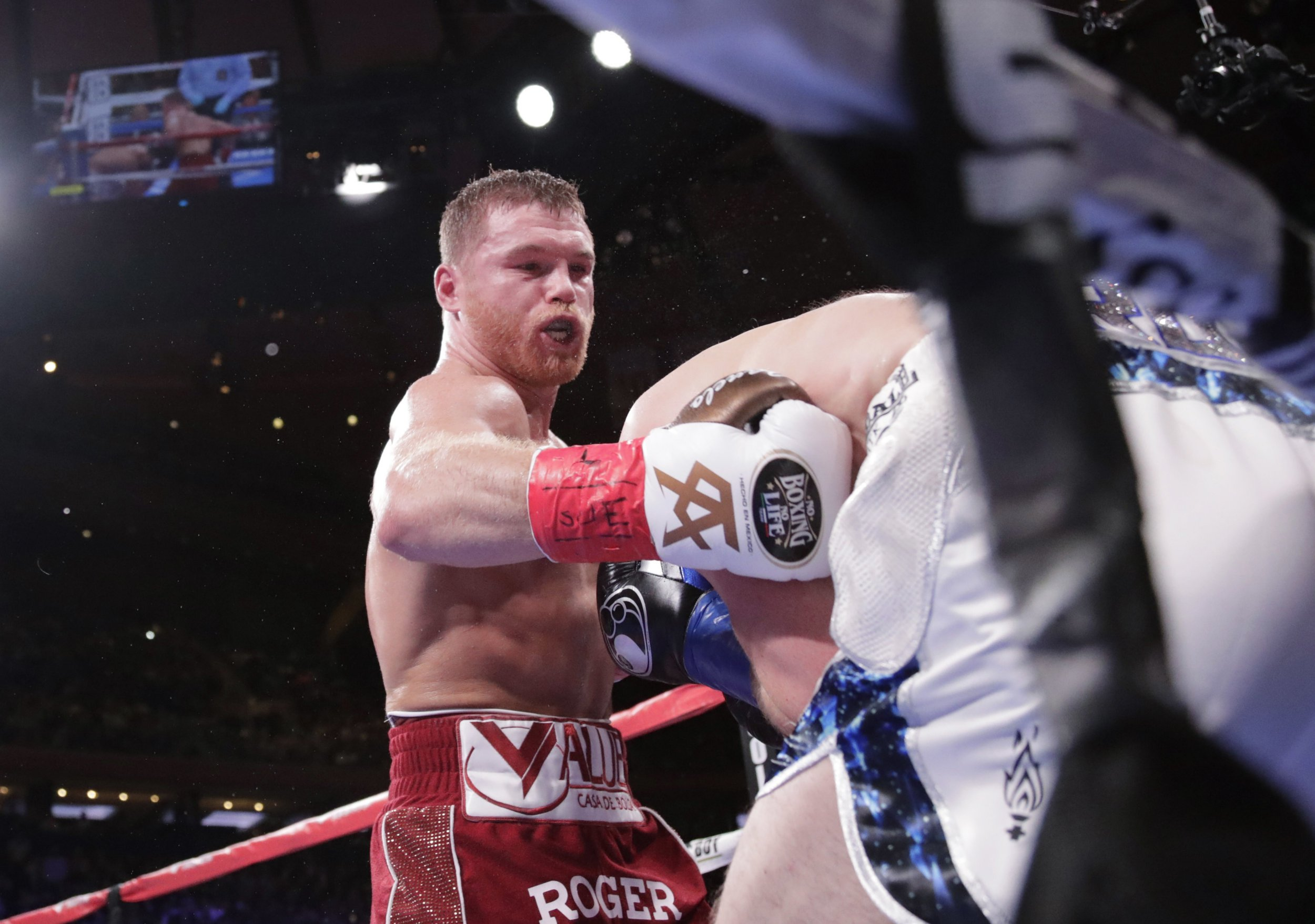 Mexico's Canelo Alvarez, left, punches England's Rocky Fielding during the third round of a WBA super middleweight championship boxing match Saturday, Dec. 15, 2018, in New York. Alvarez stopped Fielding in the third round. (AP Photo/Frank Franklin II)