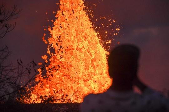 Mandatory Credit: Photo by Robert Hanashiro-USA Today Sport/Sipa USA/REX/Shutterstock (9692422e) A resident watches lava from Kilauea Volcano shoot into the air out of cracks in the earth Kilauea volcano eruption, Pahoa, Hawaii - 23 May 2018