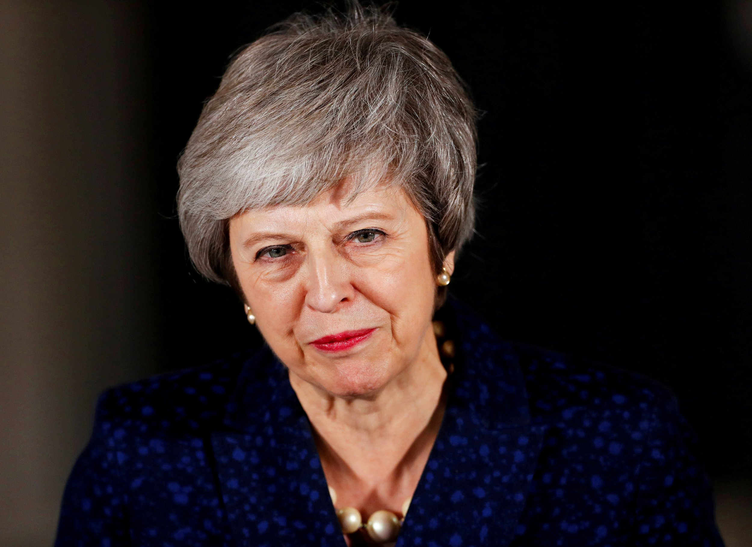 FILE PHOTO: Britain's Prime Minister Theresa May speaks outside 10 Downing Street after a confidence vote by Conservative Party members of parliament, in London, Britain December 12, 2018. REUTERS/Eddie Keogh/File Photo