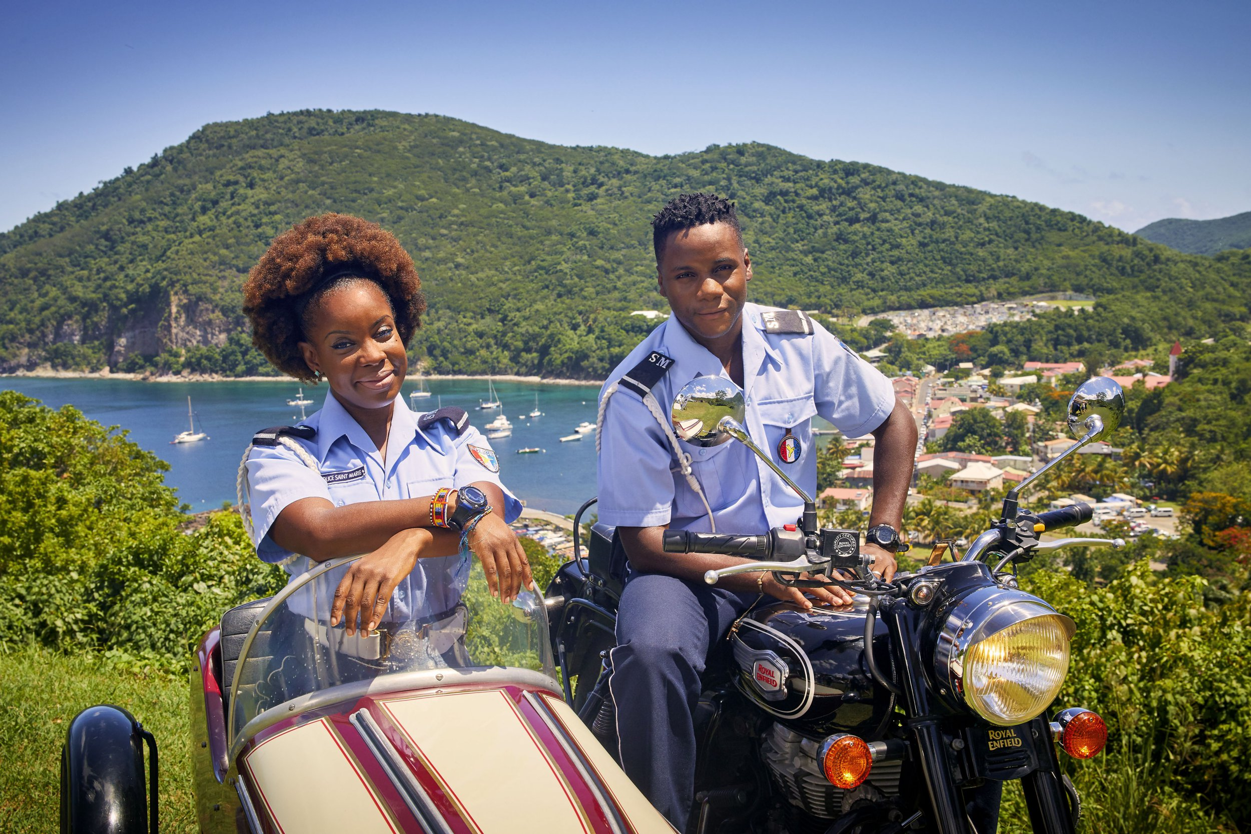 WARNING: Embargoed for publication until 00:00:01 on 28/12/2018 - Programme Name: Death in Paradise - TX: n/a - Episode: Generics (No. Generics) - Picture Shows: **STRICTLY EMBARGOED UNTIL 00:01 HRS ON TUESDAY 28TH DECEMBER 2018** Ruby (SHYKO AMOS), JP (TOBI BAKARE) - (C) Red Planet Pictures - Photographer: Denis Guyenon