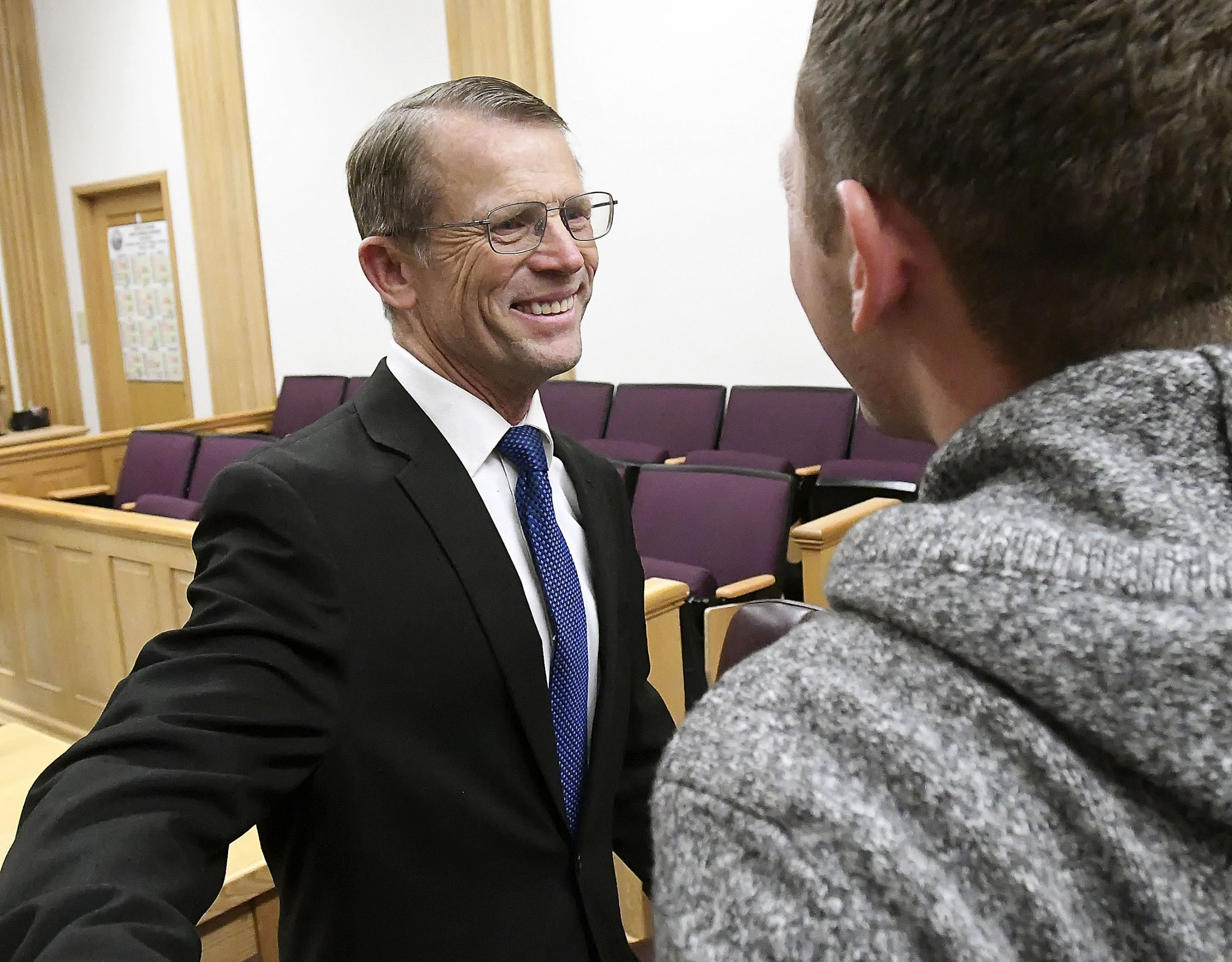 Robert Crosland smiles at son Mario Crosland after Robert was found not guilty of misdemeanor animal cruelty, Friday, Jan. 4, 2019, in Preston, Idaho. Crosland was on trial for feeding a live puppy to a snapping turtle in front of students at Preston Junior High School. (Eli Lucero/Herald Journal via AP)
