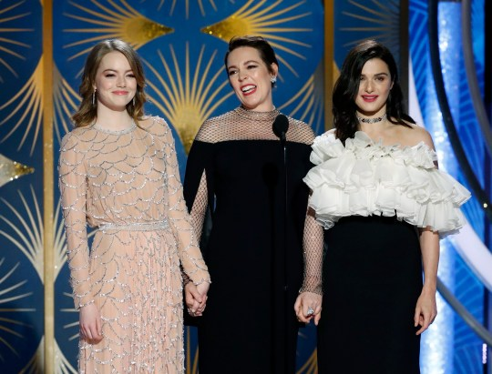 This image released by NBC shows presenters Emma Stone, from left, Olivia Colman, Rachel Weisz during the 76th Annual Golden Globe Awards at the Beverly Hilton Hotel on Sunday, Jan. 6, 2019 in Beverly Hills, Calif. (Paul Drinkwater/NBC via AP)