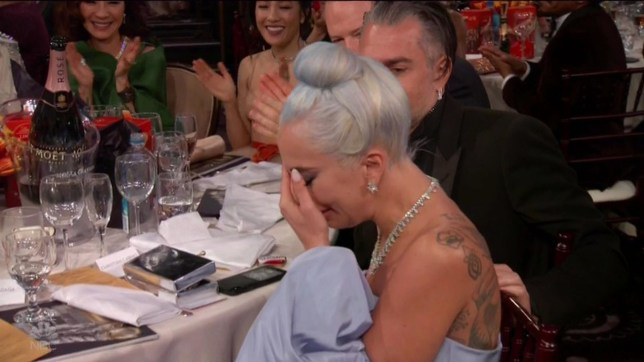 """BGUK_1449509 - ** RIGHTS: WORLDWIDE EXCEPT IN UNITED STATES ** Los Angeles, CA - Lady Gaga bursts into tears as she wins a Golden Globe for Best Original Song for Shallow. Lady Gaga was emotional as she earned her very first Golden Globe and opened up about it being 'hard to be taken seriously' as a woman in music. The 32-year-old singer and actress accepted the Best Original Song trophy for her work on A Star Is Born smash hit Shallow. When Taylor Swift and Idris Elba declared her the winner, Gaga's eyes welled up with tears. After giving A Star Is Born director and costar Bradley Cooper a hug, a tear-filled Gaga took the stage alongside her fellow songwriters Mark Ronson, Andrew Wyatt, and Anthony Rossomando to accept the award for the song. During the acceptance speech she said: """"I just have to say, as a woman in music, it is really hard to be taken seriously as a musician and a songwriter. These three incredible men, they lifted me up and supported me."""" Gaga then added: """"Bradley, I love you."""" Songwriter Mark Ronson also gave Cooper, who directed and starred in A Star Is Born, a sweet shoutout. """"Thank you, Bradley Cooper. You took our heartfelt honest tune and you gave it emotional resonance,"""" he said. Pictured: Lady Gaga BACKGRID UK 6 JANUARY 2019 BYLINE MUST READ: NBC / BACKGRID *BACKGRID DOES NOT CLAIM ANY COPYRIGHT OR LICENSE IN THE ATTACHED MATERIAL. ANY DOWNLOADING FEES CHARGED BY BACKGRID ARE FOR BACKGRID'S SERVICES ONLY, AND DO NOT, NOR ARE THEY INTENDED TO, CONVEY TO THE USER ANY COPYRIGHT OR LICENSE IN THE MATERIAL. BY PUBLISHING THIS MATERIAL , THE USER EXPRESSLY AGREES TO INDEMNIFY AND TO HOLD BACKGRID HARMLESS FROM ANY CLAIMS, DEMANDS, OR CAUSES OF ACTION ARISING OUT OF OR CONNECTED IN ANY WAY WITH USER'S PUBLICATION OF THE MATERIAL* UK: +44 208 344 2007 / uksales@backgrid.com USA: +1 310 798 9111 / usasales@backgrid.com *UK Clients - Pictures Containing Children Please Pixelate Face Prior To Publication*"""