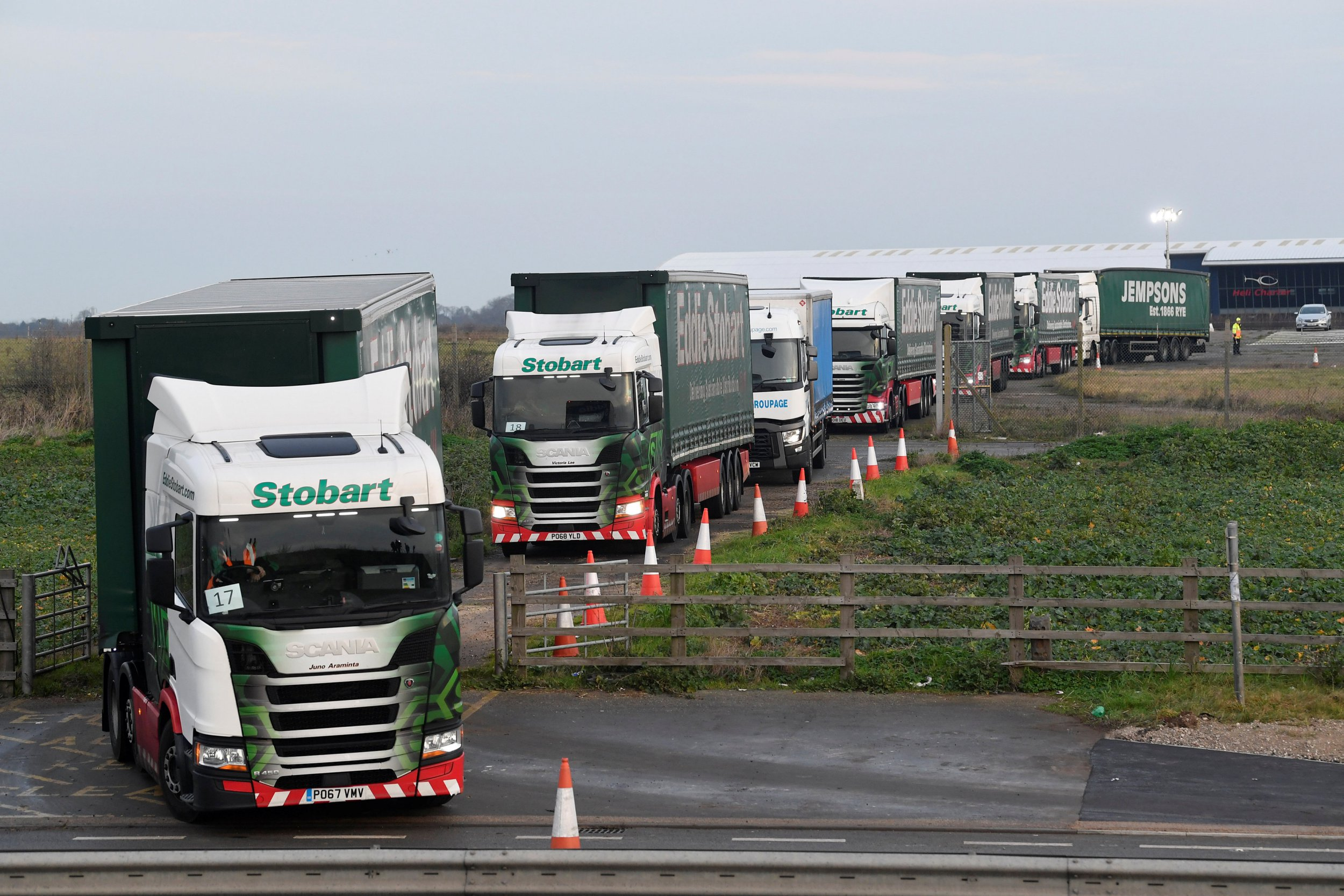 """Lorries leave disused Manston Airport to attend a test drive to the Port of Dover during a trial of how road will cope in case of a """"no-deal"""" Brexit, Kent, Britain January 7, 2019. REUTERS/Toby Melville"""