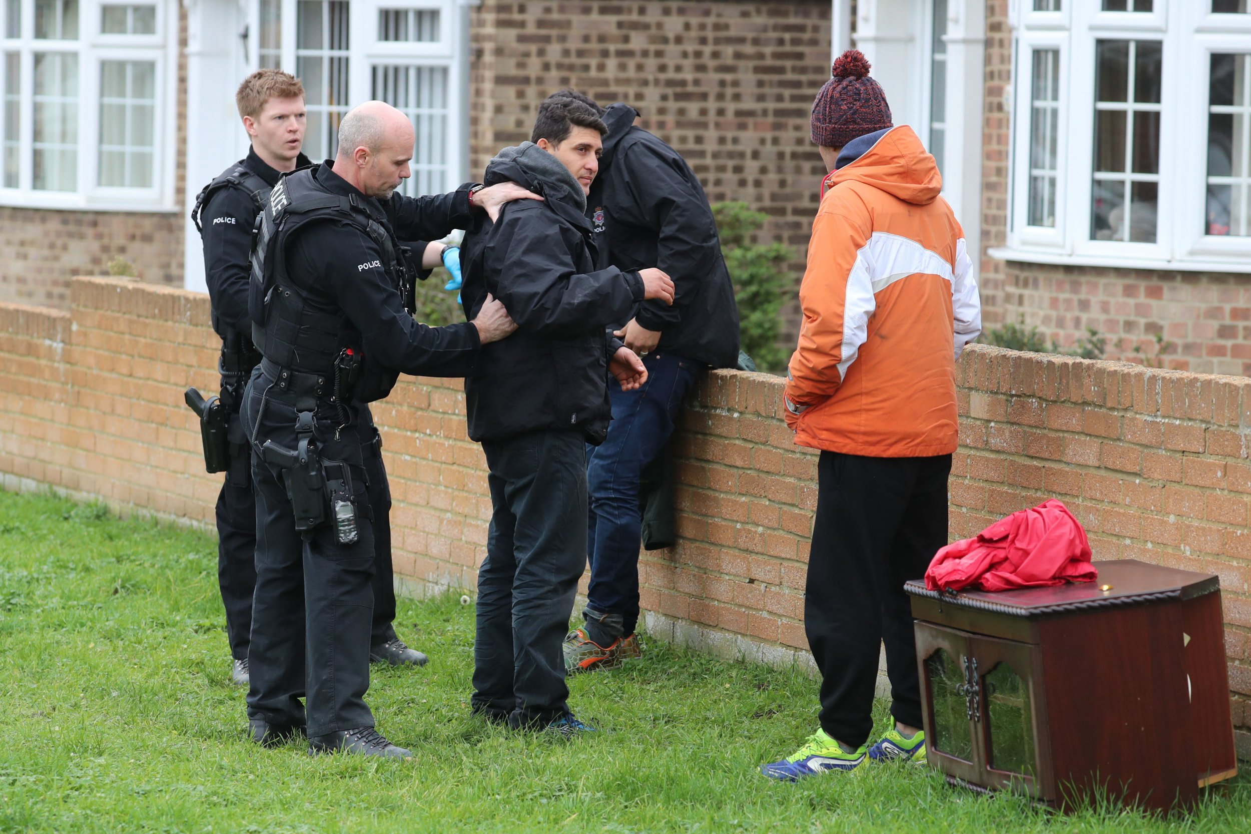 Police take care of migrants found following a search which was launched when an empty inflatable boat was found on Dungeness beach in Kent at about 8.10am this morning. PRESS ASSOCIATION Photo. Picture date: Monday January 7, 2019. See PA story POLITICS Migrants. Photo credit should read: Gareth Fuller/PA Wire