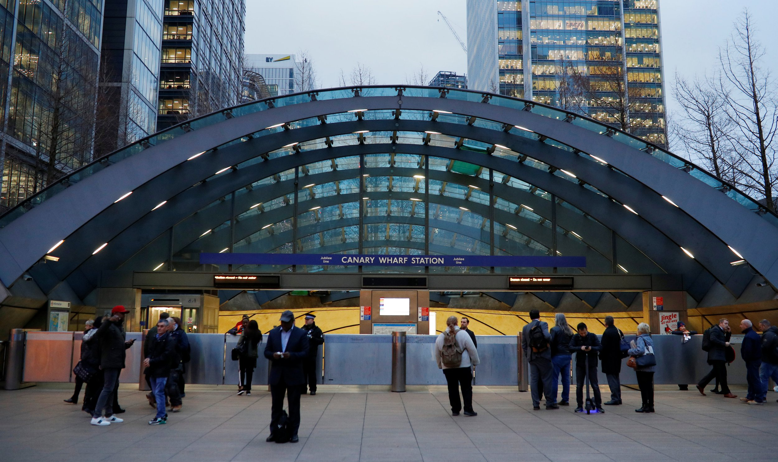Commuters are seen outside a closed Canary Wharf tube station following an incident at the station in London, Britain, January 7, 2019. REUTERS/Phil Noble