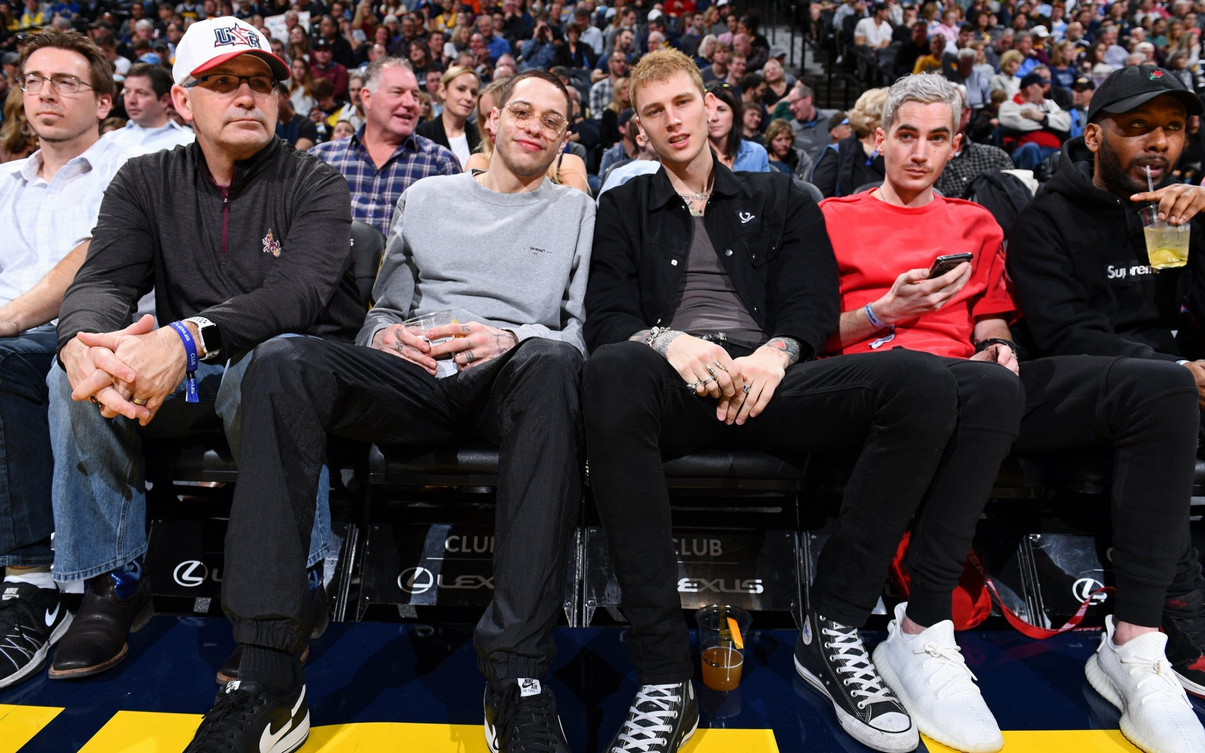 DENVER, CO - JANUARY 05: Comedian, Pete Davidson and Rapper, Machine Gun Kelly attend the Charlotte Hornets game against the Denver Nuggets on January 05, 2019 at the Pepsi Center in Denver, Colorado. NOTE TO USER: User expressly acknowledges and agrees that, by downloading and/or using this Photograph, user is consenting to the terms and conditions of the Getty Images License Agreement. Mandatory Copyright Notice: Copyright 2019 NBAE (Photo by Garrett Ellwood/NBAE via Getty Images)
