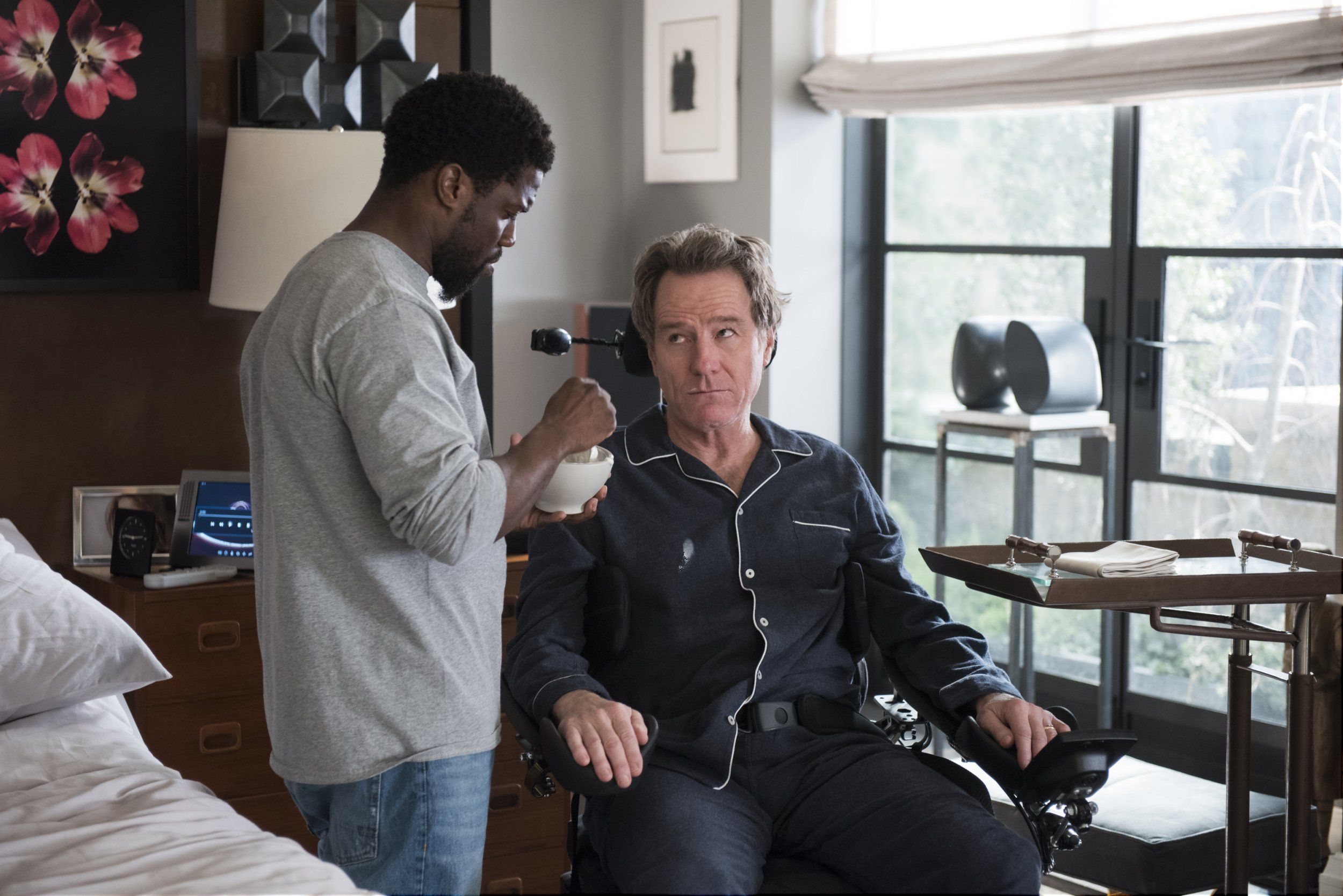 "This image released by STXfilms shows Kevin Hart, left, and Bryan Cranston in a scene from ""The Upside."" (David Lee/STXfilms via AP)"