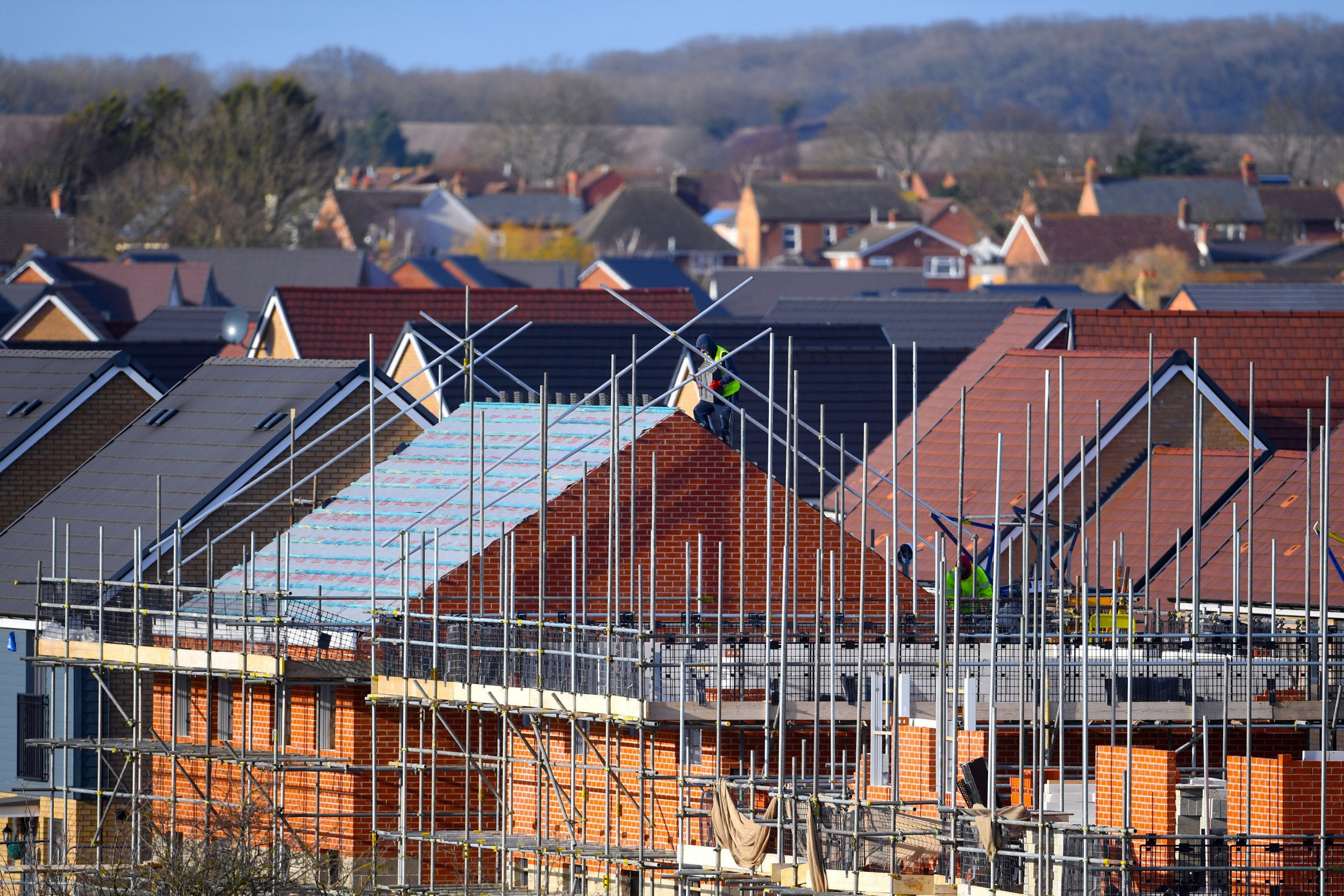 File photo dated 01/02/18 of houses under construction on a new housing development. A housing charity has called for the Government to spend ?214 billion in creating three million new homes to solve the social housing crisis. PRESS ASSOCIATION Photo. Issue date: Tuesday January 8, 2019. In the wake of the Grenfell disaster, Shelter brought together 16 independent commissioners from across the political spectrum to write a report on the issue. See PA story POLITICS Housing. Photo credit should read: Joe Giddens/PA Wire