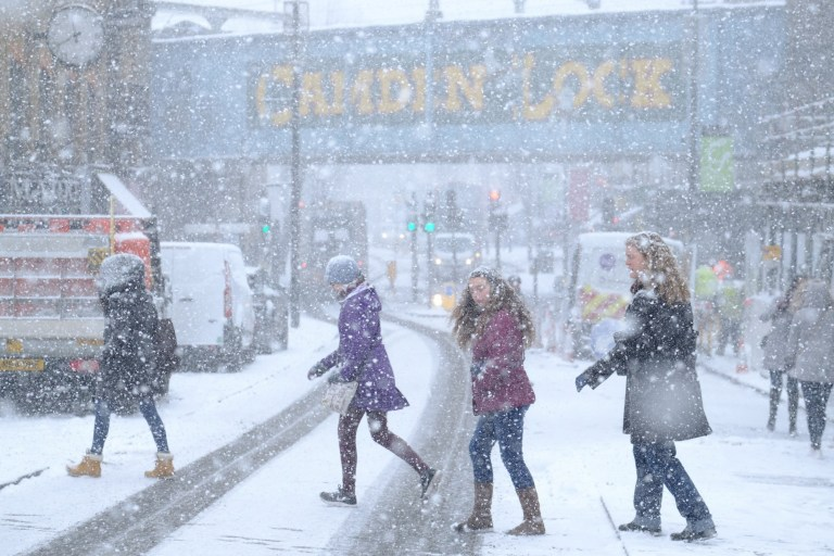 """People cross the road in Camden during a snow blizzard in London, United Kingdom, on February 28, 2018. Siberian winds continue to blow the """"Beast from the East"""" across the country and Storm Emma threatens to bring more snow in the coming days. (Photo by Alex Milan Tracy/Sipa USA)"""