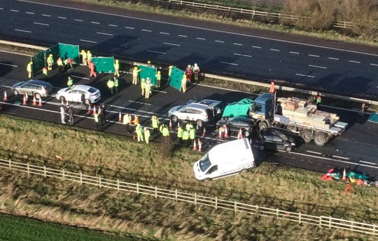 Man 'fighting for life' and three injured in M58 crash