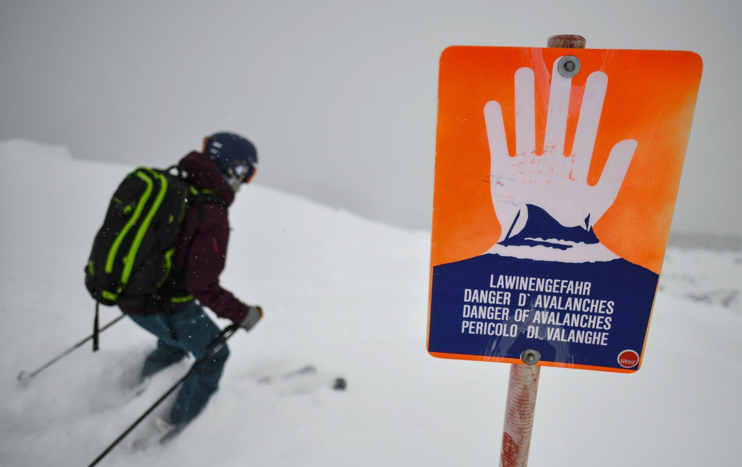 LERMOOS, AUSTRIA - JANUARY 10: A backcountry skier passes an avalanche warning sign at the sidecountry boundary of a ski resort on January 10, 2019 in Lermoos, Austria. Exceptionally high levels of snow have closed roads and ski resorts, triggered avalanches and cut villages off across southern Germany and much of Austria. (Photo by Philipp Guelland/Getty Images)