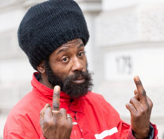 Alleged Grenfell fraudster Alvin Thompson, 50, who claimed to be living in the stairwell of Grenfell Tower, and subsequently received financial and accommodation benefits to the tune of ?85,000, makes an obscene gesture as he leaves Westminster Magistrates Court in London. London, January 10 2019.