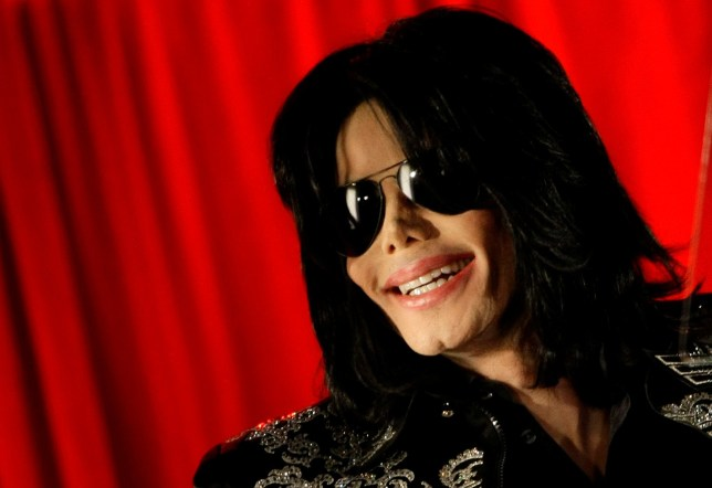 FILE PHOTO: U.S. pop star Michael Jackson gestures during a news conference at the O2 Arena in London March 5, 2009. Jackson said he will hold a series of final concerts in Britain later in the year. REUTERS/Stefan Wermuth/File Photo