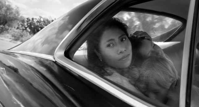"This image released by Netflix shows Yalitza Aparicio in a scene from the film ""Roma,"" by filmmaker Alfonso Cuaron. Aparicio portrays Cleo, a domestic worker who works for a woman whose husband abandons her and their four children. (Alfonso Cuar??n/Netflix via AP)"
