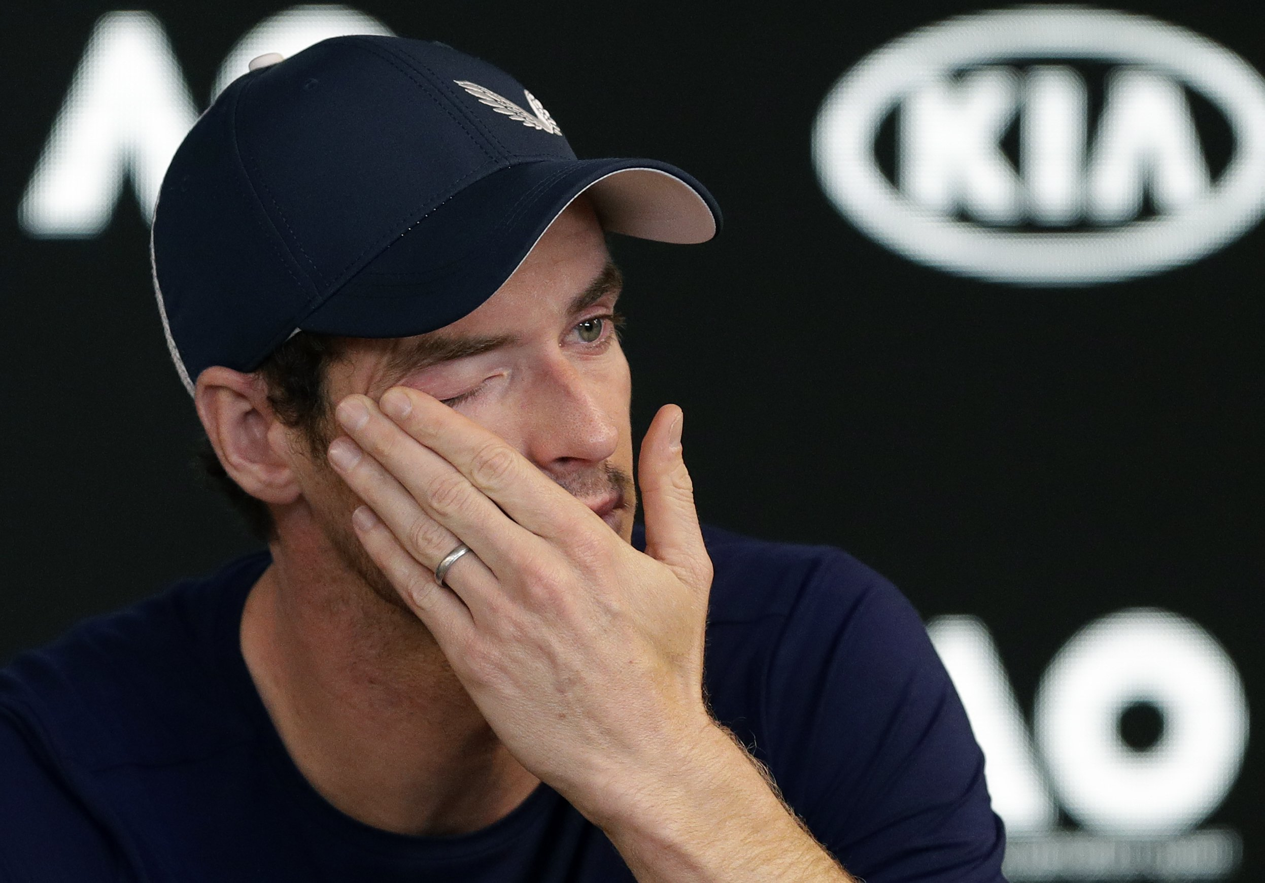 Britain's Andy Murray wipes tears from his face during a press conference at the Australian Open tennis championships in Melbourne, Australia, Friday, Jan. 11, 2019. A tearful Murray says the Australian Open could be his last tournament because of a hip injury that has hampered him for almost two years.(AP Photo/Mark Baker)