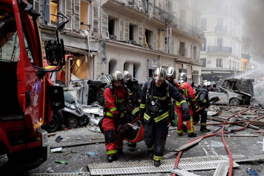 Firefighters evacuate an injured person after the explosion of a bakery on the corner of the streets Saint-Cecile and Rue de Trevise in central Paris on January 12, 2019. (Photo by Thomas SAMSON / AFP)THOMAS SAMSON/AFP/Getty Images