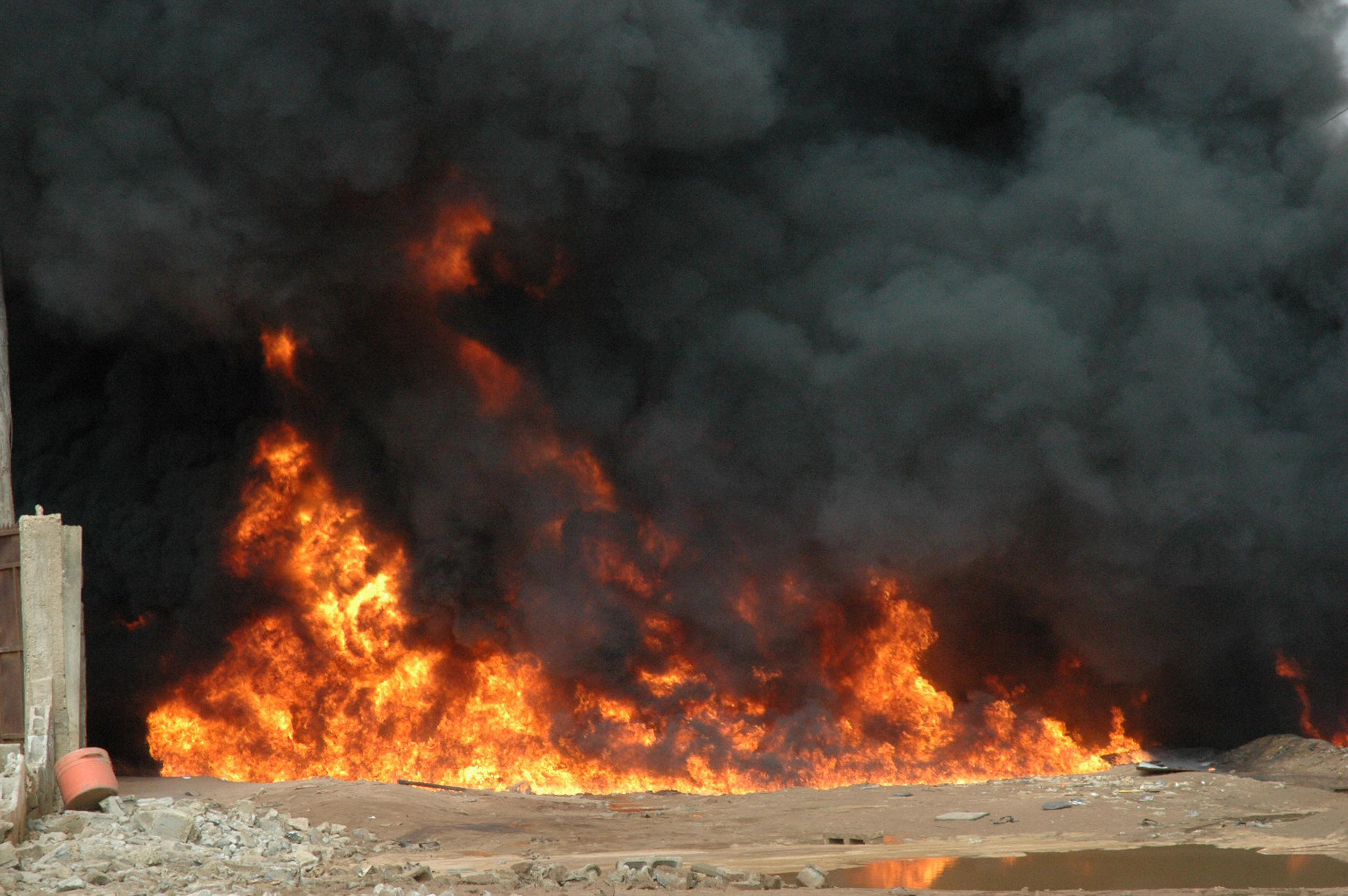 Smoke rises from a blaze on May 15, 2008 in a northern suburb of Lagos following an explosion on an oil pipeline reportedly ruptured by a piece of earthmoving equipment. The fire has claimed the lives of at least ten people and injured 36 others said Abdulsalam Mohammed, a spokesman for the country's national emergency agency at the scene. AFP PHOTO / STR (Photo credit should read STRINGER/AFP/Getty Images)