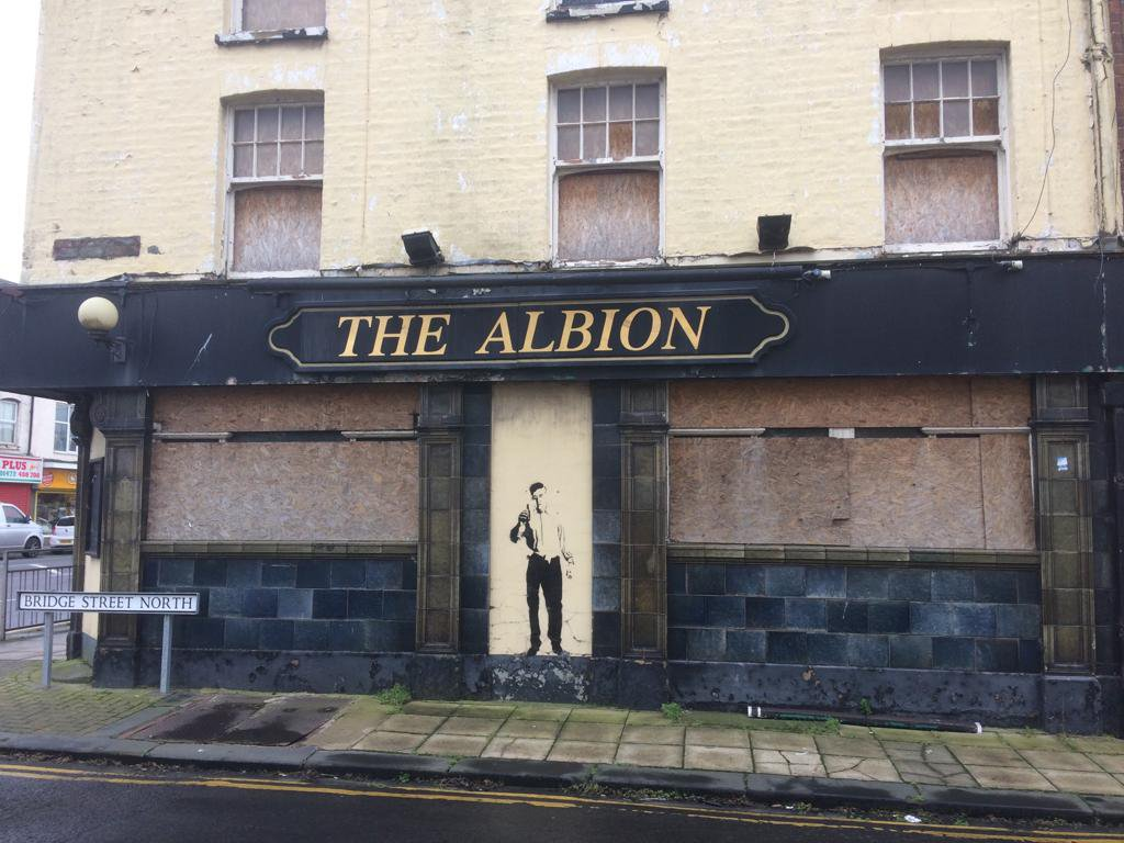 A figure of a man has appeared overnight in a blocked-up doorway inside the Albion pub on Cleethorpe Road, Grimsby, leading to speculation it is a Banksy. Credit: GrimsbyLive/MEN