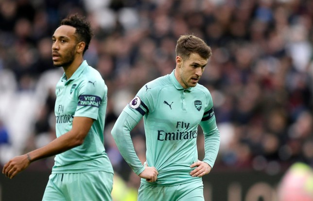 Arsenal's Aaron Ramsey and Pierre-Emerick Aubameyang, left, react during the English Premier League soccer match between West Ham United and Arsenal at London Stadium in London, Saturday, Jan. 12, 2019. (AP Photo/Tim Ireland)