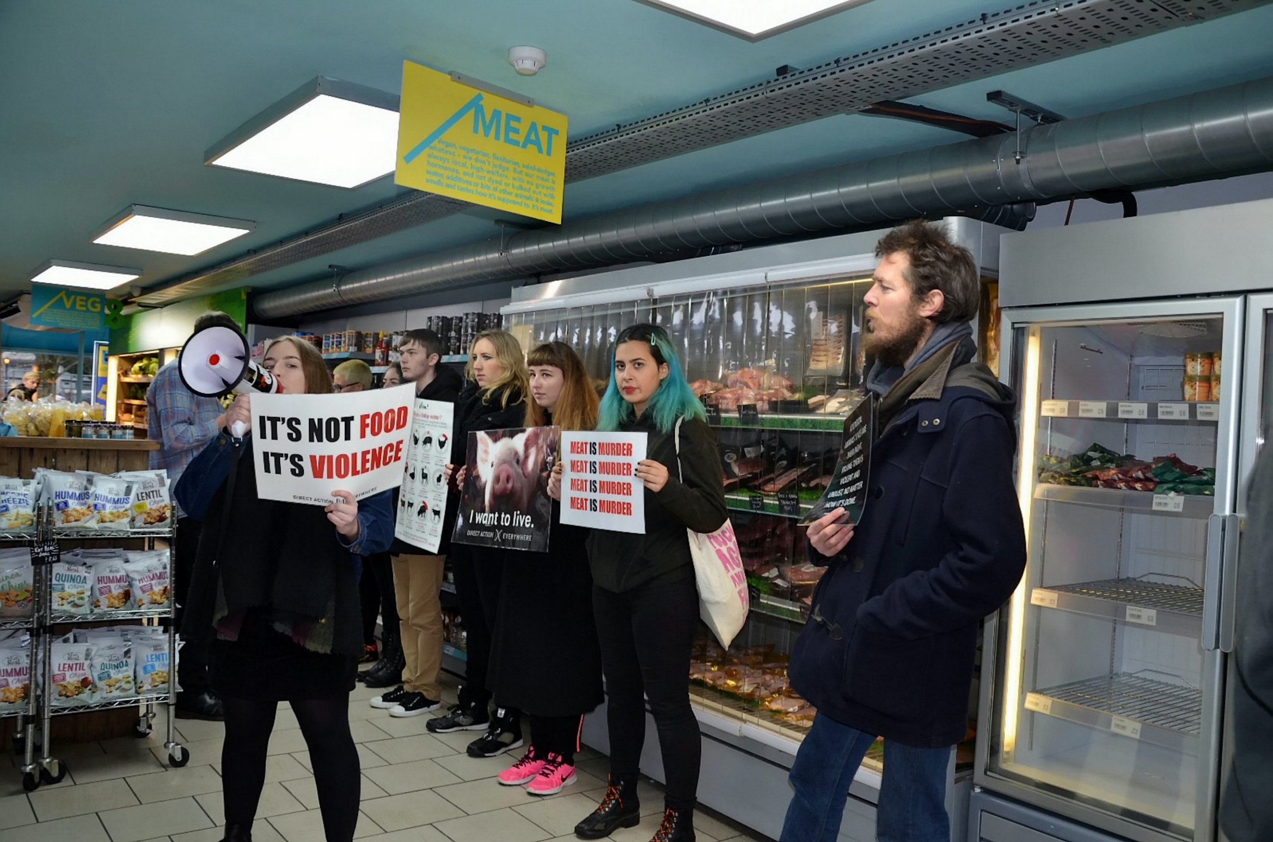 Vegan activists storm an ethical supermarket in Brighton, East Sussex, after learning it sold milk and eggs. .See National News story Nnvegans. Vegan activists stormed a hipster ethical supermarket because they were unhappy about it selling eggs and milk.Hisbe sustainable food shop works with farms where animals are treated with care and respect and sells locally sourced and free range produce.But the supermarket in Brighton, East Sussex, was targeted by Direct Action Everywhere (DxE) who intimidated staff and customers inside when they shouted at them through megaphones.The international grassroots group accused the business of 'unethical' practices and 'false advertising' because it claims to sell 'happy' meat.