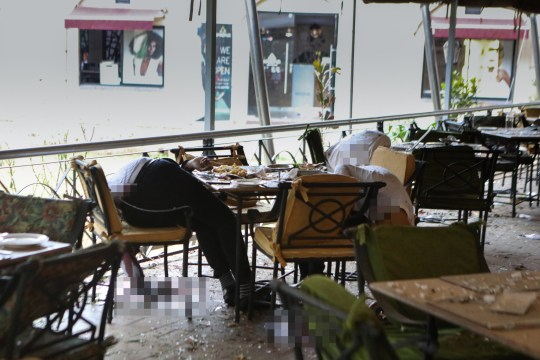 epa07287122 Motionless bodies of victims are seen on a table at a restaurant during an ongoing gunfire and explosions in Nairobi, Kenya, 15 January 2019. According to reports, a large explosion and sustained gunfire sent workers fleeing for their lives at an upscale hotel and office complex in the Kenyan capital of Nairobi. EPA/DANIEL IRUNGU EDITORS IMAGE CONTAINS GRAPHIC CONTENT