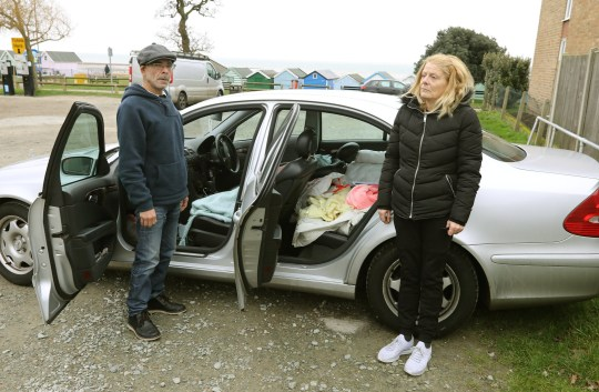 Tina and Winston Reid who are sleeping in a car in Mersea Island, Essex. See SWNS copy SWCAcar: A couple have been living out of their car for eight weeks as they are struggling to find housing. Tina and Winston Reid, both 54, were living in a private house in Romford for four years. However, their landlord decided to sell the house and they were forced to leave. They bought a caravan in Thurrock, which they lived in for two years, but eight weeks ago, they had a sewage problem which drove them out of the caravan and left them homeless.