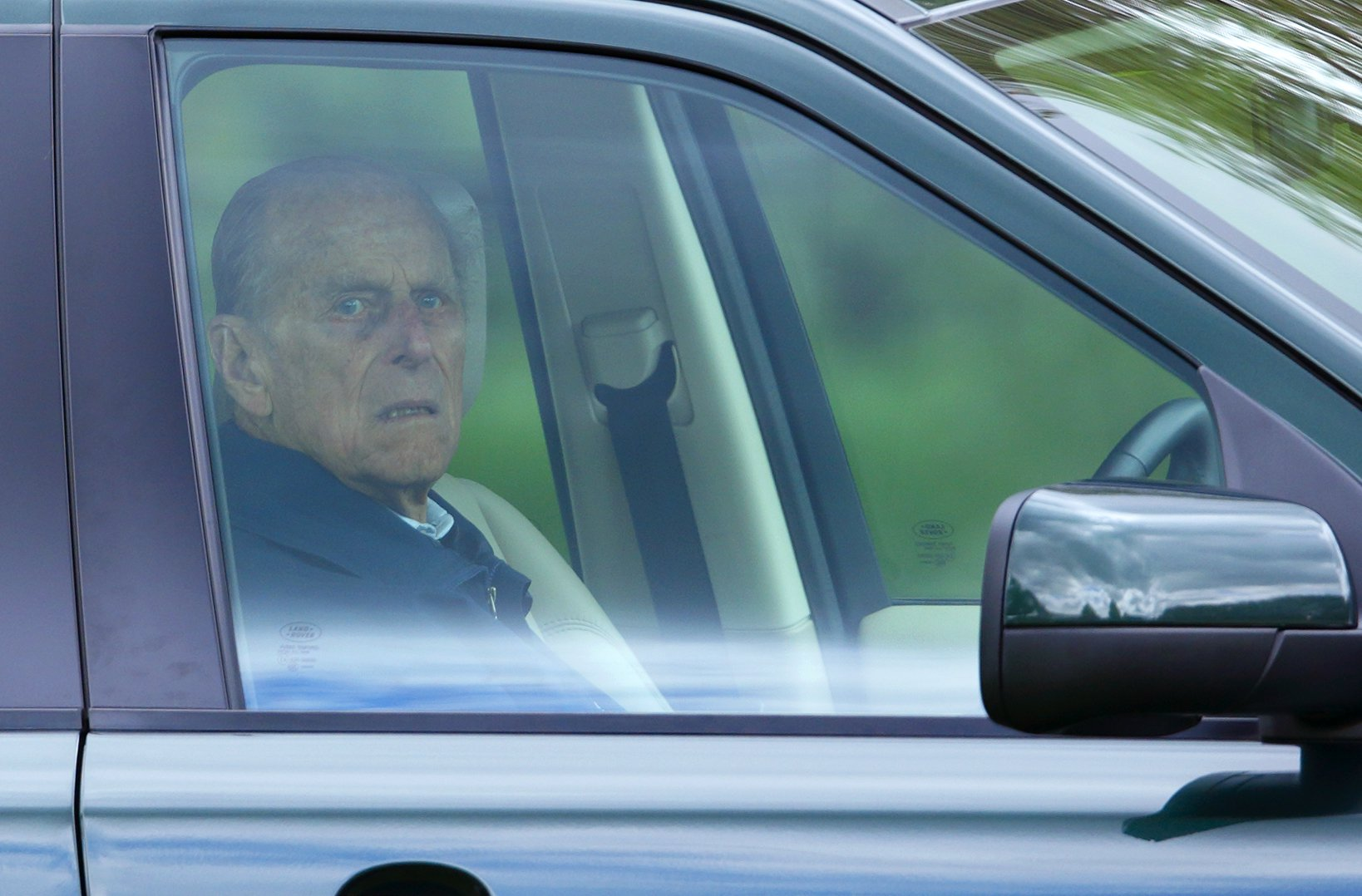 WINDSOR, UNITED KINGDOM - MAY 09: (EMBARGOED FOR PUBLICATION IN UK NEWSPAPERS UNTIL 48 HOURS AFTER CREATE DATE AND TIME) Prince Philip, Duke of Edinburgh sits in his Land Rover Freelander to watch the dressage phase of the Land Rover International Driving Grand Prix competition on day 2 of the Royal Windsor Horse Show on May 9, 2013 in Windsor, England. (Photo by Max Mumby/Indigo/Getty Images)