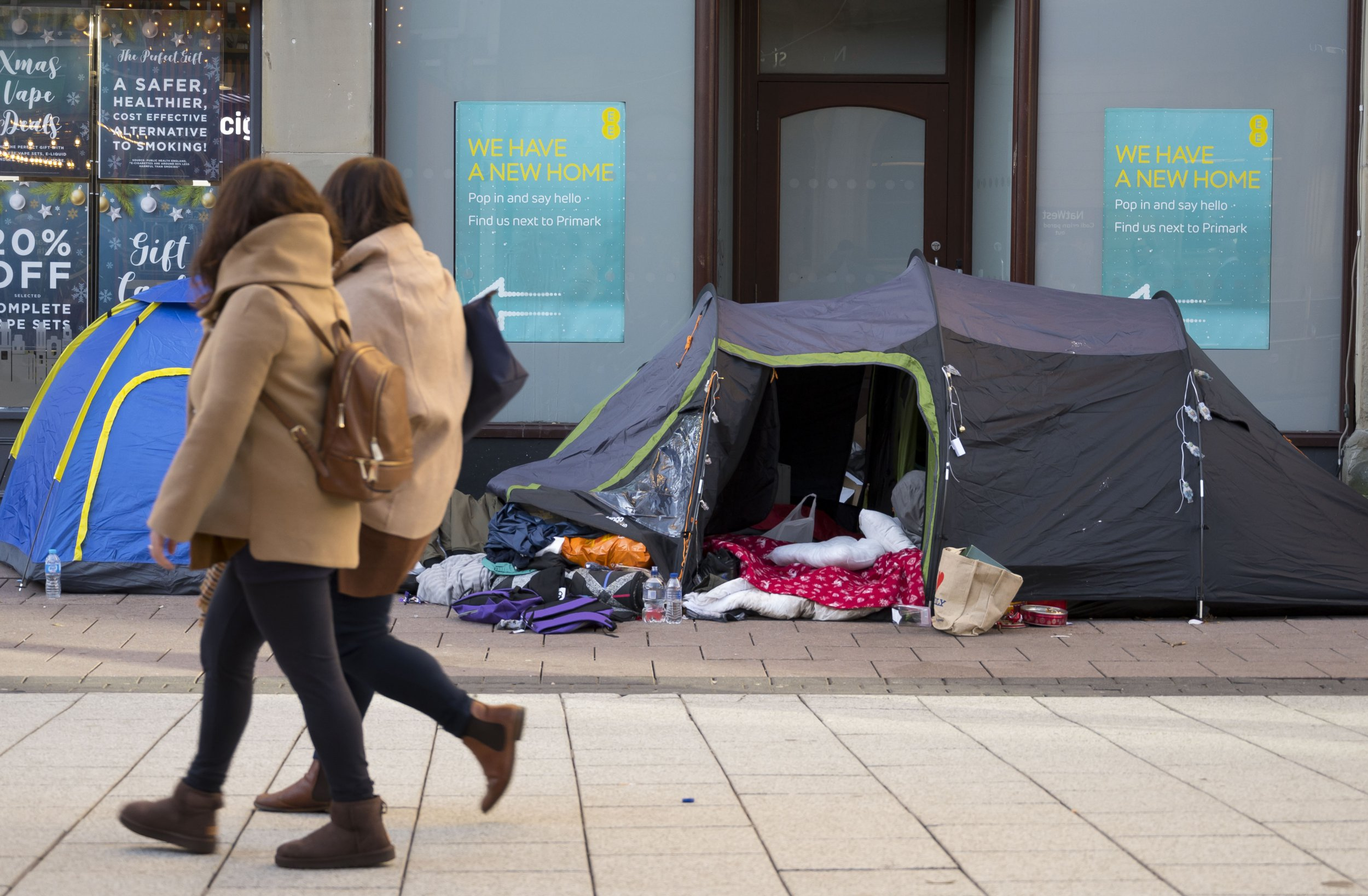 CARDIFF, WALES - DECEMBER 27: Shoppers walk passed tents on Queen Street on December 27, 2018 in Cardiff, United Kingdom. A large number of homeless have pitched tents on the busy shopping street. Bigger discounts than normal are expected in the traditional post-Christmas sales as retailers try to make up for weak trading in the run-up to Christmas. (Photo by Matthew Horwood/Getty Images)