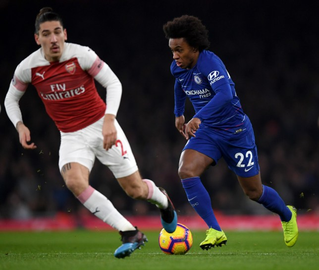 LONDON, ENGLAND - JANUARY 19: Willian of Chelsea runs with the ball under pressure from Hector Bellerin of Arsenal during the Premier League match between Arsenal FC and Chelsea FC at Emirates Stadium on January 19, 2019 in London, United Kingdom. (Photo by Darren Walsh/Chelsea FC via Getty Images)