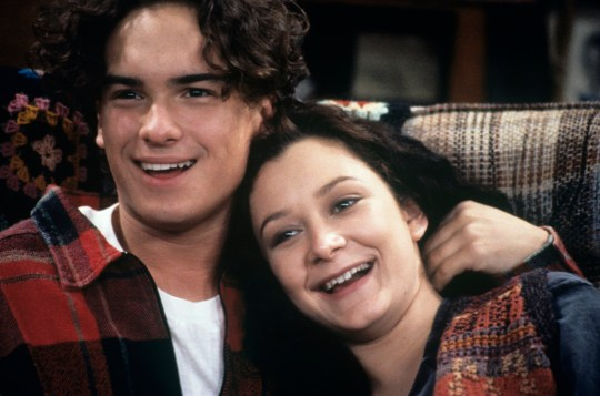 """UNITED STATES - SEPTEMBER 28: ROSEANNE - """"Party Politics"""" - Season Six - 9/28/93, Johnny Galecki (David), Sara Gilbert (Darlene) on the ABC Television Network comedy """"Roseanne"""". Jackie and Roseanne plan a house-warming party for Jackie's new home., (Photo by ABC Photo Archives/ABC via Getty Images)"""
