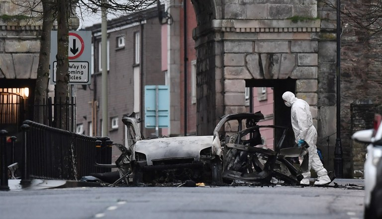 LONDONDERRY, NORTHERN IRELAND - JANUARY 20: A forensic officer inspects the remains of the van used as a car bomb on an attack outside Derry Court House on January 20, 2019 in Londonderry, Northern Ireland. Dissident republicans are suspected to have carried out the attack which has been condemed by Northern Ireland politicians. (Photo by Charles McQuillan/Getty Images)