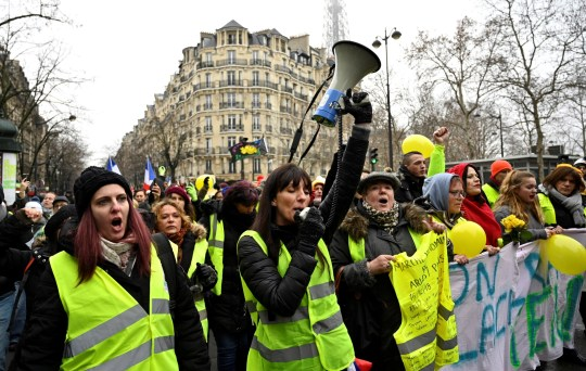 PARIS, FRANCE - JANUARY 20: French women yellow vests (Gilets jaunes) protesters walk near the Eiffel Tower during a women yellow vest demonstration against deteriorating economic conditions in Paris, France on January 20, 2019. (Photo by Mustafa Yalcin/Anadolu Agency/Getty Images)