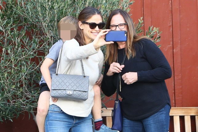 Brentwood, CA - *EXCLUSIVE* - Jennifer Garner takes her son Samuel to get his hair cut from the barber shop. Jennifer and Sam are seen taking their dog along for the outing. Pictured: Jennifer Garner BACKGRID USA 19 JANUARY 2019 BYLINE MUST READ: BIAG / BACKGRID USA: +1 310 798 9111 / usasales@backgrid.com UK: +44 208 344 2007 / uksales@backgrid.com *UK Clients - Pictures Containing Children Please Pixelate Face Prior To Publication*