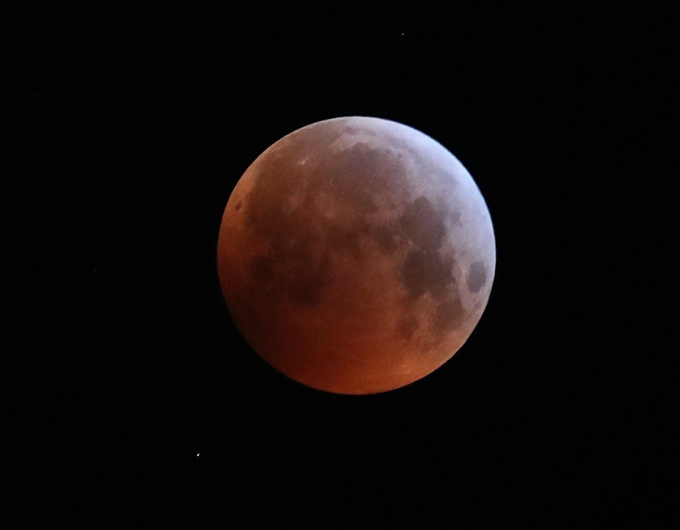 "A super blood wolf moon over Brighton during a lunar eclipse. PRESS ASSOCIATION Photo. Picture date: Monday January 21, 2019. A total lunar eclipse colours the lunar surface a reddish hue at the same time it appears brighter and closer to earth than normal, seeing phenomena known as a blood moon and supermoon combine. And in January, the full moon is sometimes labelled a ""wolf"" moon, creating the unusual celestial label which seems to have stuck. See PA Story SCIENCE Eclipse. Photo credit should read: Andrew Matthews/PA Wire"