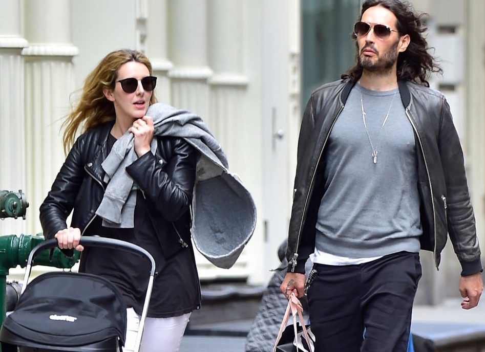 Russell Brand criticised after claiming he's crap at changing nappies because he's 'not willing to fight any battles'