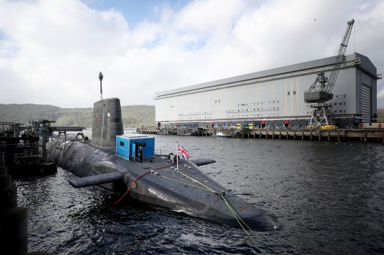 """File photo dated 29/09/2017 of the Vanguard-class nuclear deterrent submarine HMS Vengeance at HM Naval Base Clyde, Faslane, the infrastructure for supporting the Royal Navy's fleet of nuclear submarines is no longer """"fit for purpose"""", MPs have warned."""