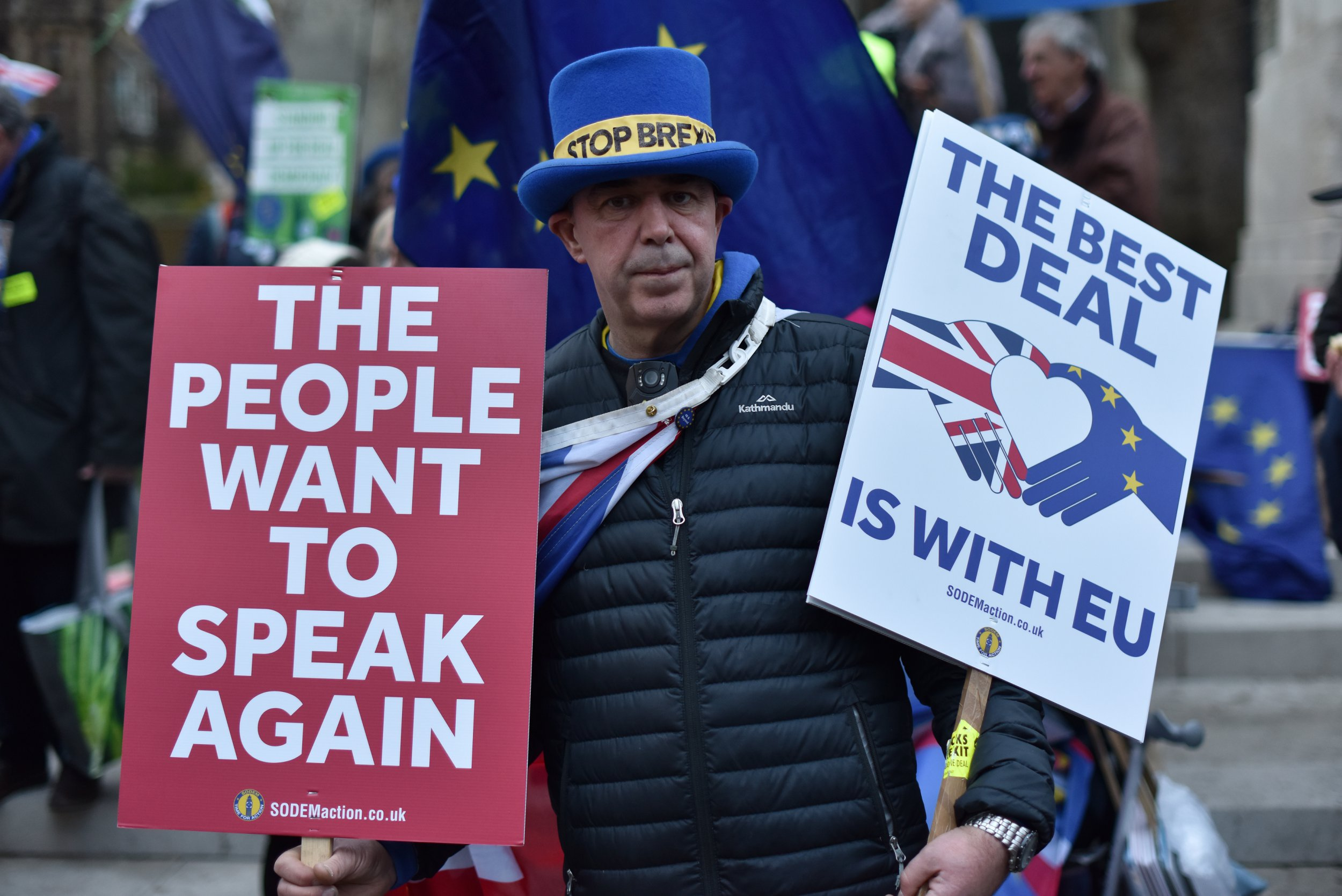 "Anti Brexit protester Steve Bray holds placard saying ""The people want to speak again and The best deal is with the EU"" outside the Houses of Parliament"