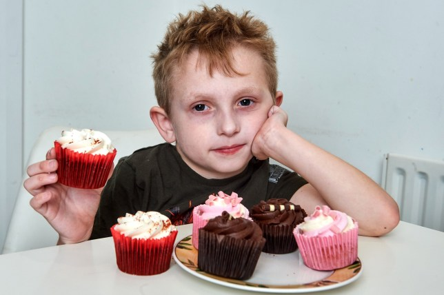 PIC FROM Simon Jacobs/Caters News - (PICTURED: 22/01/2019 Hoddesdon, UK. Six year old Jude Carrington has an eating disorder, which means that he cannot and has not eaten solid food) - A six-year-old whose lifelong dream is to try a CUPCAKE for the first time is fundraising 50,000 with his family to ensure his wish comes true.Jude Carrington has never eaten anything since he was 10-months-old due to suffering from severe inflammation of his intestines known as eosinophilic colitis.After being tube fed for the past two years and only ever eating liquidised food, Jude has exhausted all possible options to improve his quality of life on the NHS.SEE CATERS COPY