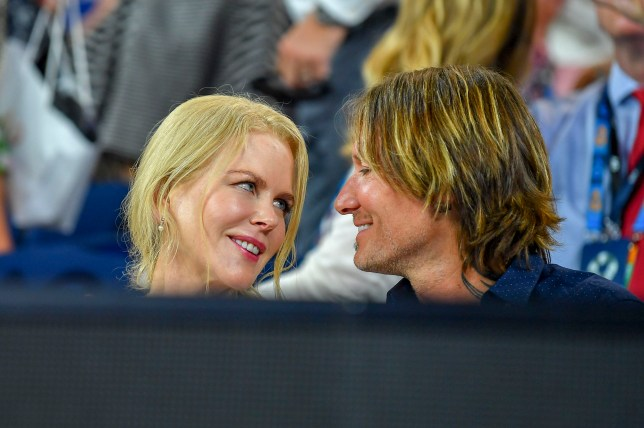 Embargo for online! ***NO WEB Until 7am EST January 25th 2019*** *NO MAIL ONLINE* Nicole Kidman and Keith Urban put on a very passionate display while watching the Australia open tennis in Melbourne. The couple were spotted having a very intimate moment as Nicole puckered up for a kiss with her husband. Pictured: Nicole Kidman,Keith Urban Ref: SPL5057862 240119 NON-EXCLUSIVE Picture by: Media-Mode / SplashNews.com Splash News and Pictures Los Angeles: 310-821-2666 New York: 212-619-2666 London: 0207 644 7656 Milan: 02 4399 8577 photodesk@splashnews.com World Rights, No Australia Rights, No New Zealand Rights