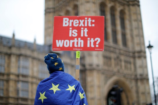 (FILES) In this file photo taken on January 14, 2019 Anti-Brexit supporters hold placards and flags as they demonstrate outside the Houses of Parliament in London. - Britain's long goodbye to the European Union often seems to be spoken in unintelligible code. Most know the process as Brexit -- a child of the term Grexit that economists invented when it looked like debt-laden Greece would exit the EU in 2012. (Photo by Tolga AKMEN / AFP)TOLGA AKMEN/AFP/Getty Images