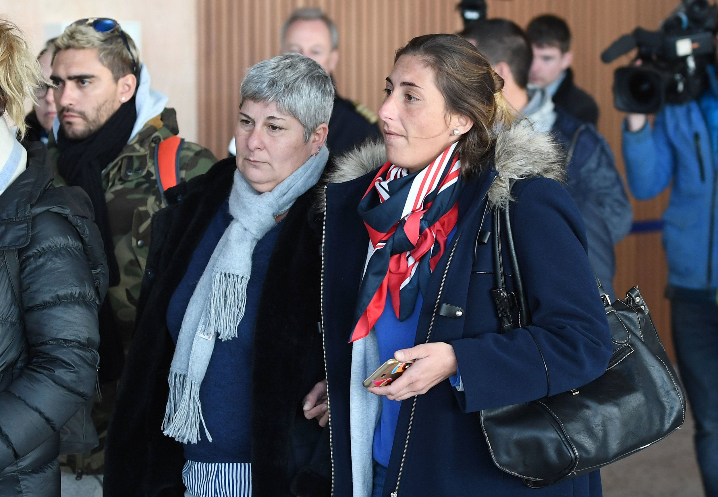 "Emiliano Sala's mother Mercedes (left) and sister Romina (right) arrive back at Guernsey airport after taking a flight to view the area of the English Channel in which the missing footballers plane was last seen. PRESS ASSOCIATION Photo. Picture date: Monday January 28, 2019. The family of Emiliano Sala are ""struggling"" for answers as a private search gets under way for the Cardiff City footballer whose plane disappeared over the English Channel. See PA story AIR Channel. Photo credit should read: Joe Giddens/PA Wire"
