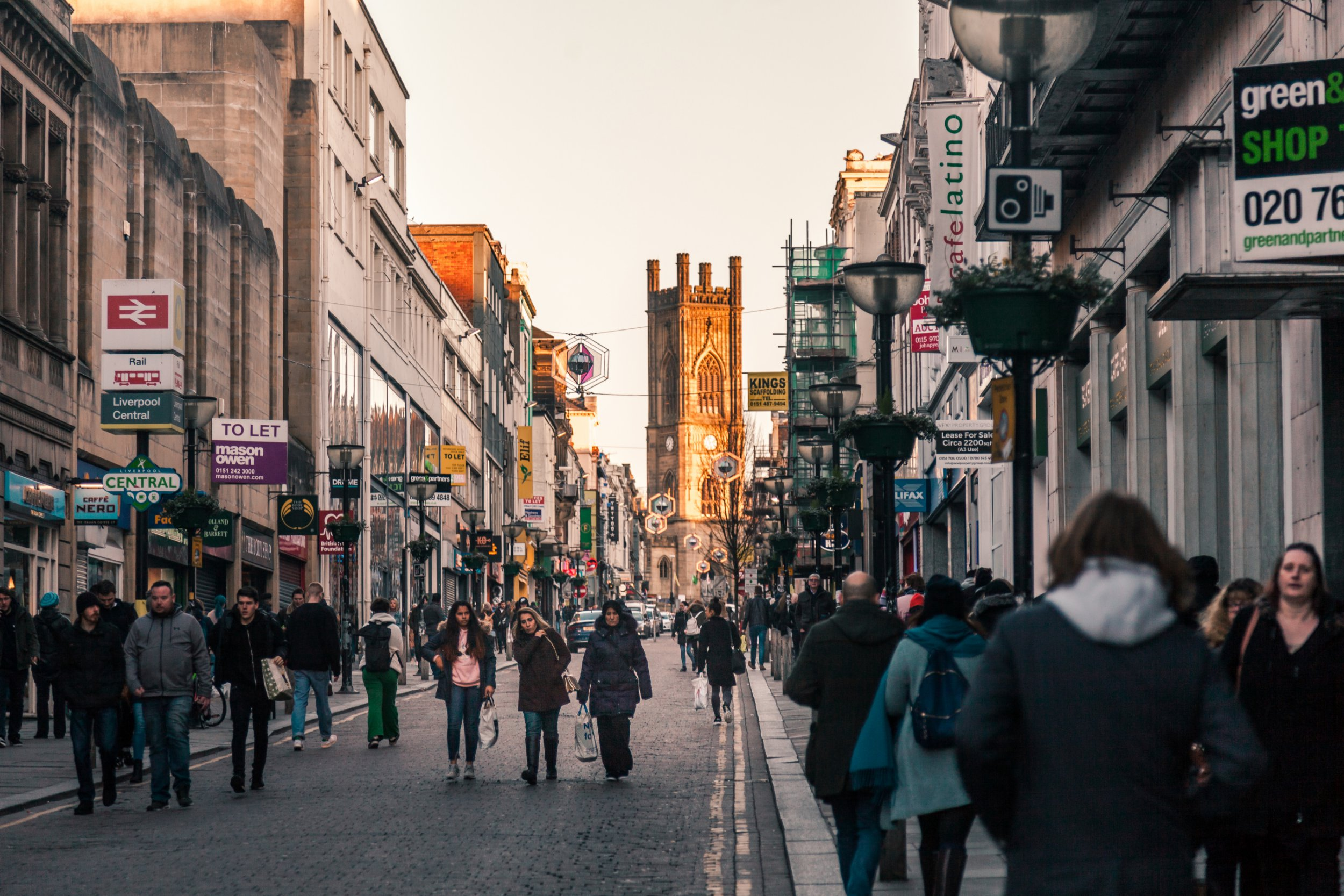 Liverpool, United Kingdom: February 25 2018 People shopping around Liverpool Central Street on a Sunny day. Bold Street located in the heart of Liverpool city, famously having small and large businesses.