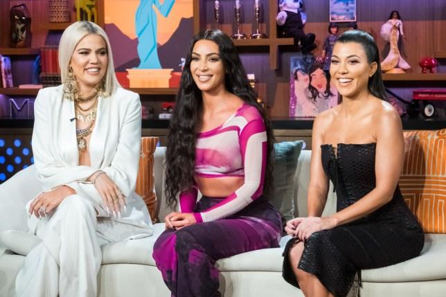 Khloe Kardashian, Kim Kardashian and Kourtney Kardashian sat next to each other