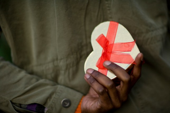 A man holding a heart-shaped gift