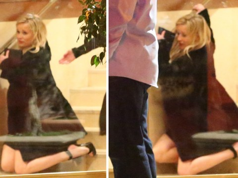 Reese Witherspoon is only human as she falls down stairs at Jennifer Aniston's 50th birthday bash